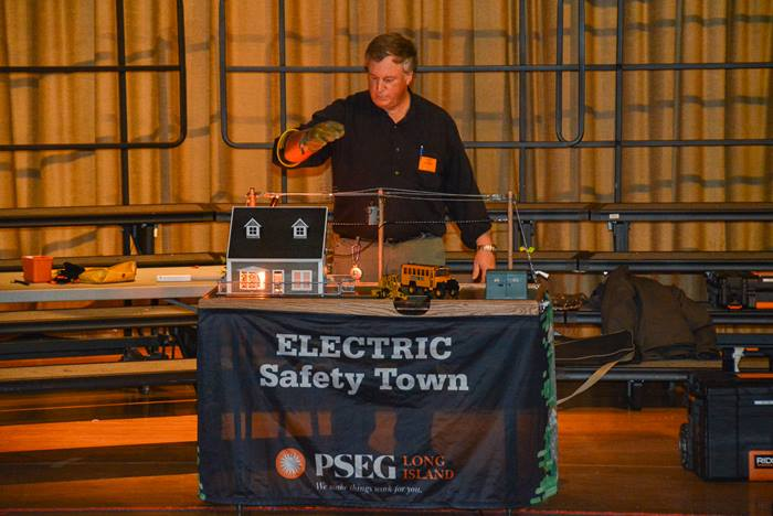 PSEG Long Island employee Bill Hewlett of West Hampton presents an Electric Safety Town demonstration to fourth graders in the Manhasset school district.