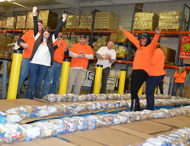 PSEG Long Island employees with a group from Island Harvest worked together in an attempt to break Guinness World Record for the longest line of hunger relief packages. Final results will be released in a few weeks.