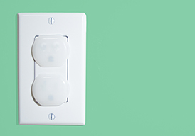 Electrical outlet with child safety plugs