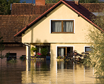 Floodwaters surrounding a house
