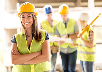 Female construction worker wearing hard hat