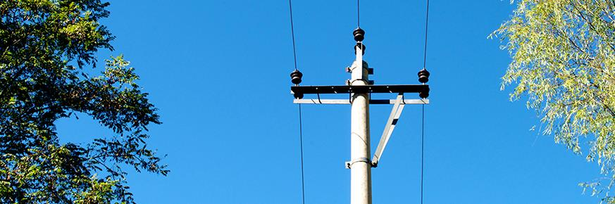 Overhead power lines against a blue sky