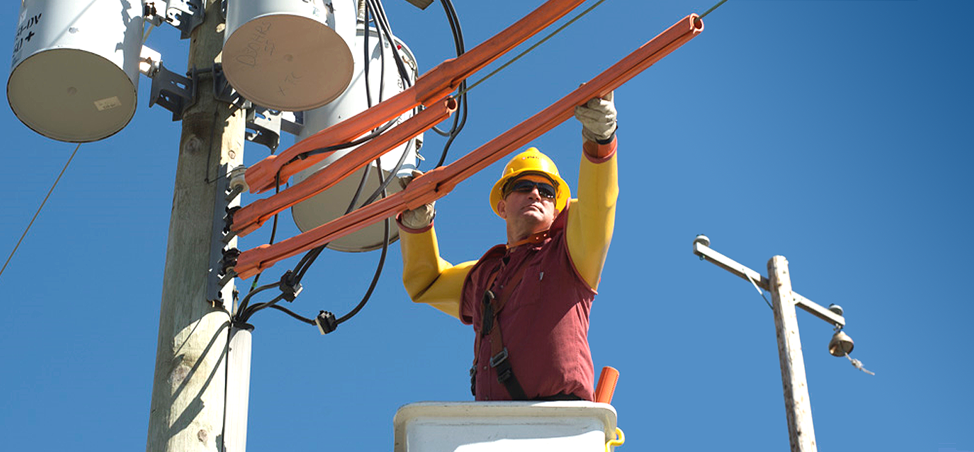 Lineworker maintaining infrastructure
